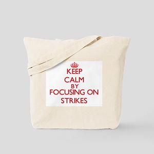 Keep Calm by focusing on Strikes Tote Bag