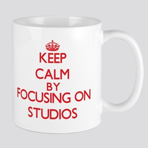 Keep Calm by focusing on Studios Mugs