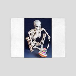 Skinny Skeleton Plays with Top 5'x7'Area Rug