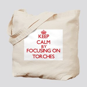 Keep Calm by focusing on Torches Tote Bag
