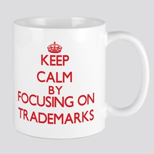 Keep Calm by focusing on Trademarks Mugs