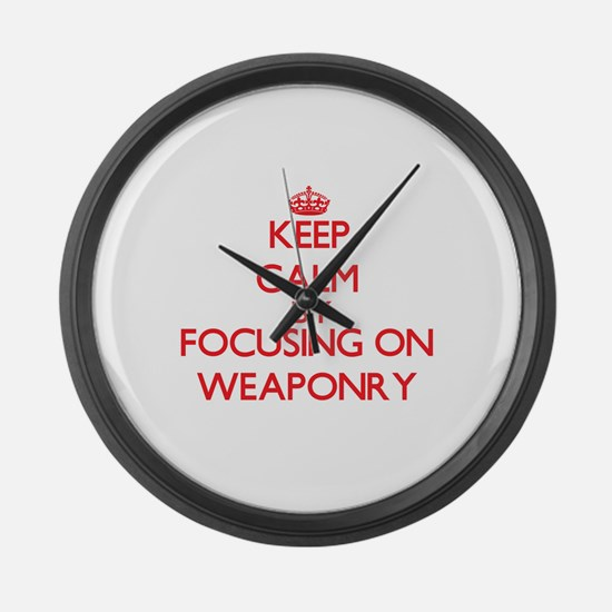Keep Calm by focusing on Weaponry Large Wall Clock