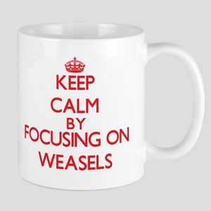 Keep Calm by focusing on Weasels Mugs