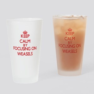 Keep Calm by focusing on Weasels Drinking Glass