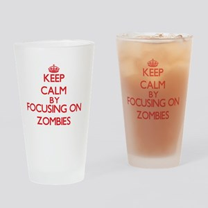 Keep Calm by focusing on Zombies Drinking Glass