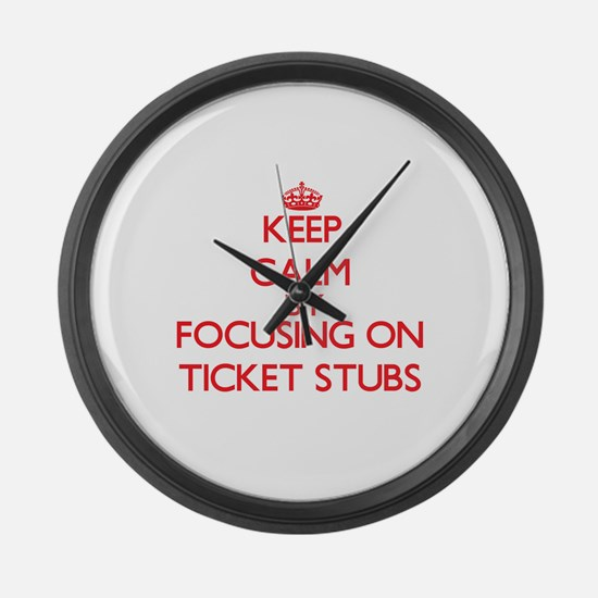 Keep Calm by focusing on Ticket S Large Wall Clock