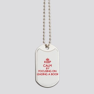 Keep Calm by focusing on Reading A Book Dog Tags