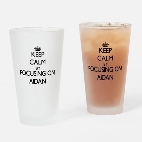 Keep Calm by focusing on on Aidan Drinking Glass