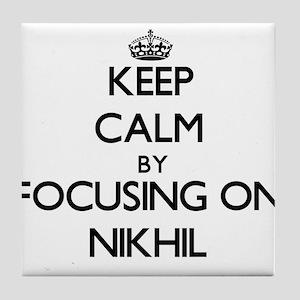 Keep Calm by focusing on on Nikhil Tile Coaster