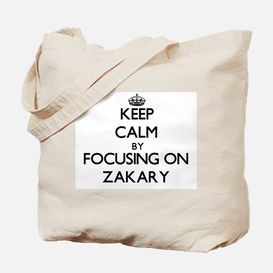 Keep Calm by focusing on on Zakary Tote Bag