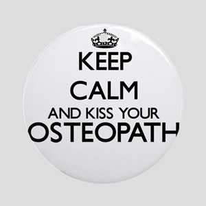 Keep calm and kiss your Osteopath Ornament (Round)