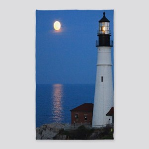 Super Moons Lighthouse View Area Rug