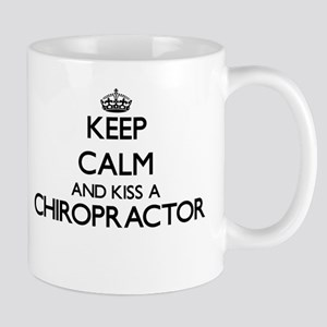 Keep calm and kiss a Chiropractor Mugs