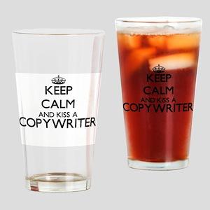 Keep calm and kiss a Copywriter Drinking Glass