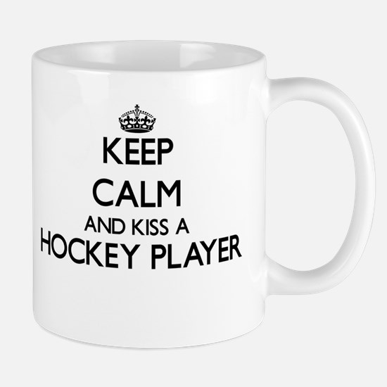 Keep calm and kiss a Hockey Player Mugs