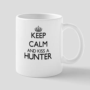 Keep calm and kiss a Hunter Mugs
