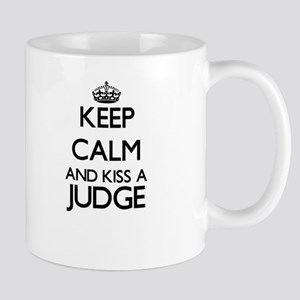 Keep calm and kiss a Judge Mugs