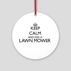 Keep calm and kiss a Lawn Mower Ornament (Round)