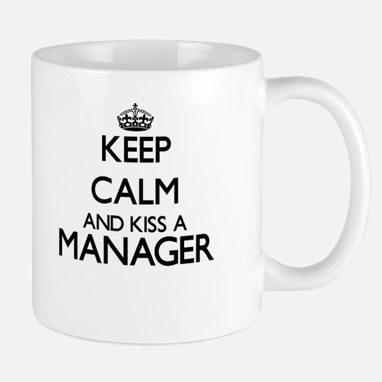 Keep calm and kiss a Manager Mugs