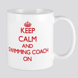 Keep Calm and Swimming Coach ON Mugs