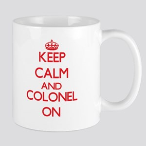 Keep Calm and Colonel ON Mugs