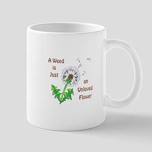 AN UNLOVED FLOWER Mugs