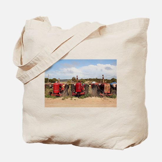 Old farm tractors machinery in country So Tote Bag