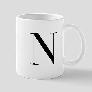 N-bod black Mugs