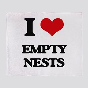 empty nests Throw Blanket
