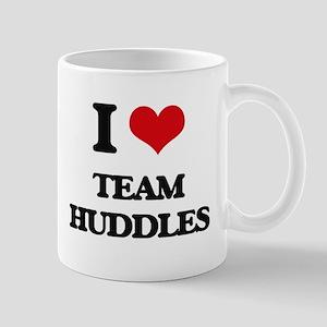 team huddles Mugs