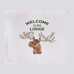 WELCOME TO THE LODGE Throw Blanket