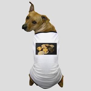 Bitcoins on a table Dog T-Shirt