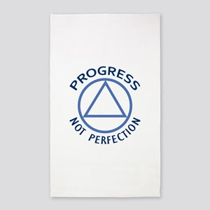 PROGRESS NOT PERFECTION Area Rug