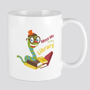Meet me at the library Mugs