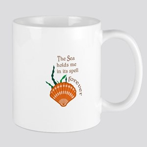 SEA HOLDS ME IN ITS SPELL Mugs