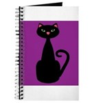 Black Cat on Purple Journal