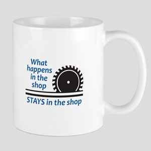 WHAT HAPPENS AT THE SHOP Mugs
