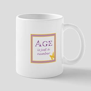 AGE IS Mugs