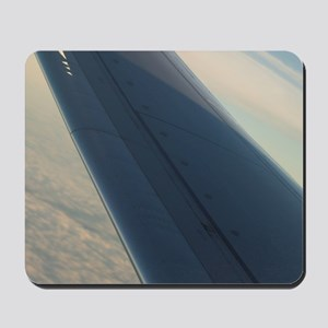 Airplane flying in sky wing in flight  Mousepad