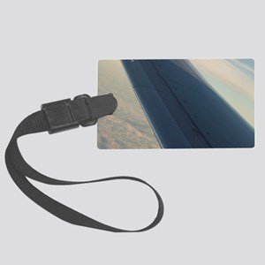 Airplane flying in sky wing in f Large Luggage Tag