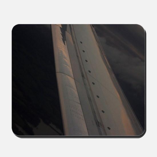 Airplane flying in sky wing in flight  Mousepad