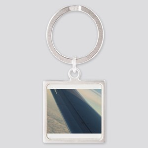 Airplane flying in sky wing in Keychains
