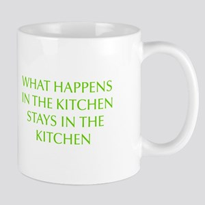 What happens in the kitchen-Opt lgreen Mugs