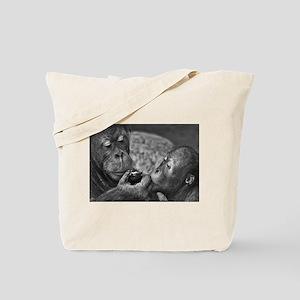 orangutans-sharing-an-apple Tote Bag