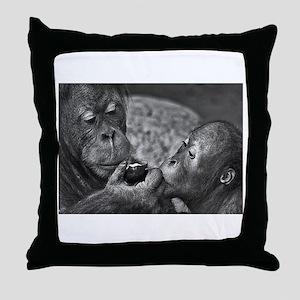 orangutans-sharing-an-apple Throw Pillow