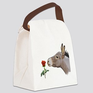 Mini donkey smelling a long stem red rose Canvas L