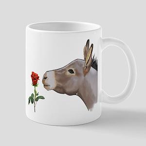 Mini donkey smelling a long stem red rose Mugs