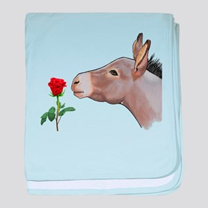 Mini donkey smelling a long stem red rose baby bla