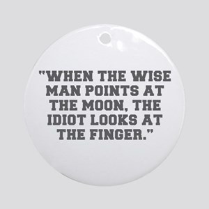 WHEN THE WISE MAN POINTS AT THE MOON THE IDIOT LOO