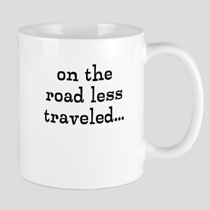 on the road less traveled Mugs